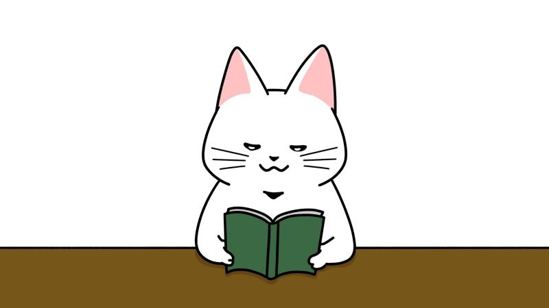 机で本を読む猫のイラスト(見出しサイズ/中央配置)